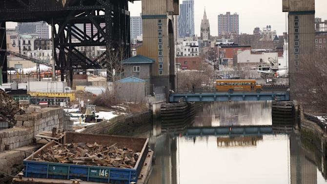 FILE - This file photo of March 2, 2010 shows the Gowanus Canal, which was added to the Superfund National Priorities List in 2010 for being heavily contaminated with PCBs, heavy metals, volatile organics and coal tar wastes. New York, New Jersey and EPA officials say toxic sites are OK after Superstorm Sandy, but The Associated Press has found that few actual tests have been done. (AP Photo/Mark Lennihan, File)