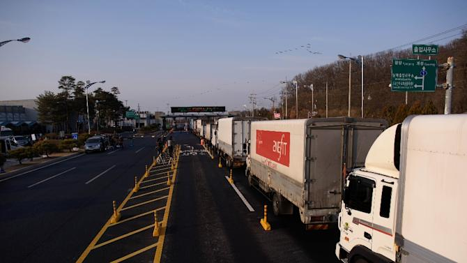 Trucks line up to enter a checkpoint leading to the Kaesong joint industrial zone, in Paju on February 11, 2016