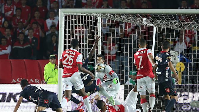 Santa Fe's goalkeeper Camilo Vargas, center, stops a shot on goal during the Colombian soccer league final game against Deportivo Independiente Medellin in Bogota, Colombia, Sunday, Dec. 21, 2014. (AP Photo/Fernando Vergara)