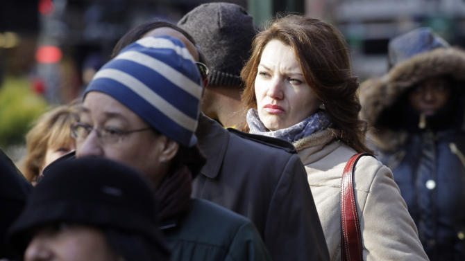 """Rasa Pasaliene waits in line to attend a job fair, Dec. 8, 2010 in New York. Pasaliene, who is currently employed, is looking for a job in healthcare that will pay her more money. """"I'm struggling with my mortgage payments now,"""" she said. (AP Photo/Mark Lennihan)"""