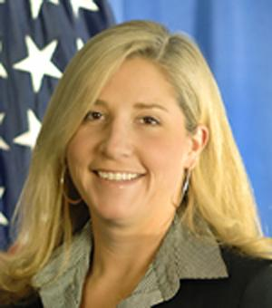 "This undated image provided by the U.S. Department of Homeland Security shows Chief of Staff Suzanne Barr. A senior agent for Immigration and Customs Enforcement and the U.S. government have agreed to settle a discrimination lawsuit out of court, according a court record filed Thursday. In a two-sentence notice, a lawyer for ICE Agent James T. Hayes Jr. said the ""parties have come to an agreement in principal"" to settle the case for $175,000. Hayes' attorney Morris Fischer, wrote that along with the money, ""a formal settlement agreement will be executed within the next several days"" that will include other conditions, including Hayes keeping his job.  Hayes filed the lawsuit in May and described a ""frat house"" environment at ICE that humiliated male employees under Barr. (AP Photo/U.S. Department of Homeland Security)"
