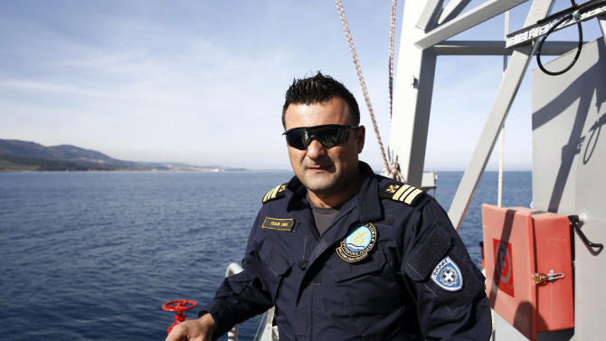 Captain Frangoulis poses for a photo on the deck of the Agios Efstratios Greek Coast Guard vessel, during a search and rescue patrol at open sea between the Turkish coast and the Greek island of Lesbos