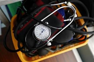 A blood-pressure machine is seen inside a basket with other medical devices at a medical centre in Athens