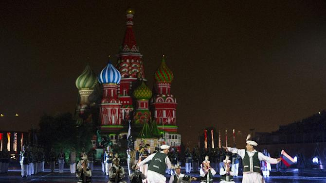 "Pakistan's Armed Forces Band members perform during the ""Spasskaya Tower"" International Military Orchestra Music Festival at the Red Square in Moscow, Russia, Friday, Sept. 4, 2015. (AP Photo/Pavel Golovkin)"