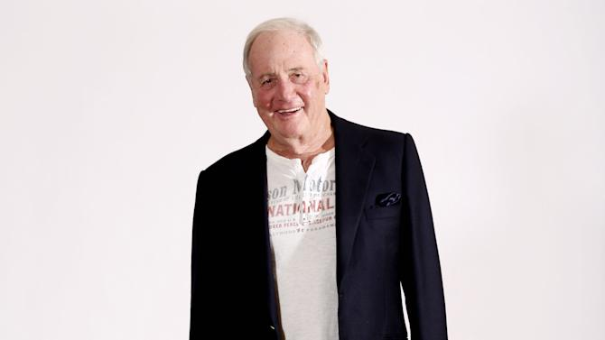 "FILE - In this Jan. 4, 2013 file photo, Jerry Weintraub, producer of the HBO film ""Behind the Candelabra,""poses for a portrait with his dog Bet during the HBO Winter TCA Tour in Pasadena, Calif.  Weintraub, the dynamic producer and manager who pushed the career of John Denver and produced such hit movies as ""Nashville"" and ""Ocean's Eleven,"" died, Monday, July 6, 2015, of cardiac arrest in Santa Barbara, Calif. He was 77. (Photo by Matt Sayles/Invision/AP, File)"