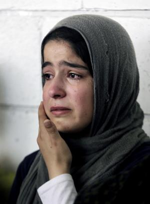 A Syrian refugee girl weeps during the visit of United …