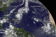 Tropical storm Humberto (lower R) and the remnants of tropical storm Gabrielle near the Bahamas are shown in this image provided by NOAA's GOES-East satellite and captured September 9, 2013. REUTERS/NASA GOES Project/Handout via Reuters