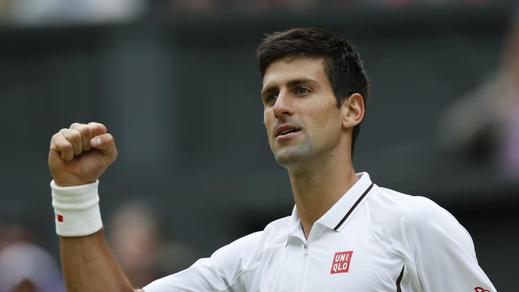 Novak Djokovic of Serbia reacts after beating Jeremy Chardy of France in their Men's singles match at the All England Lawn Tennis Championships in Wimbledon, London, Saturday, June 29, 2013. (AP Photo/Sang Tan)