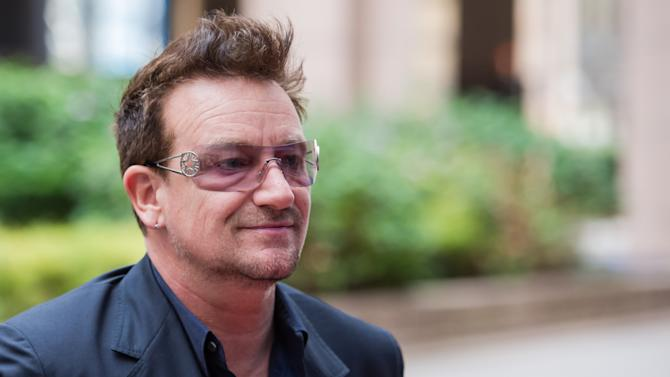 FILE - In this Tuesday, Oct. 9, 2012 file photo, U2 front man Bono, and a founder of the charity, ONE International, arrives for a meeting with European Council President Herman Van Rompuy, not seen, at the EU Council in Brussels.  Bono is one of the world's leading celebrity contributor's to charity. (AP Photo/Geert Vanden Wijngaert, File)