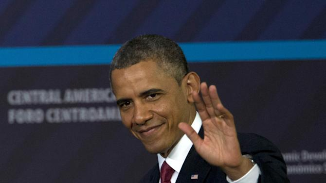 President Barack Obama waves as he arrives to participate in an Inclusive Economic Growth and Development forum in San Jose, Costa Rica, Saturday, May 4, 2013.  (AP Photo/Moises Castillo)
