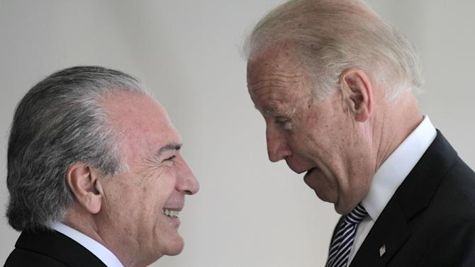 U.S. Vice President Joe Biden, right, talks with Brazil's Vice President Michel Temer during a photo opportunity at the Itamaraty palace in Brasilia, Friday, May 31, 2013. (AP Photo/Eraldo Peres)