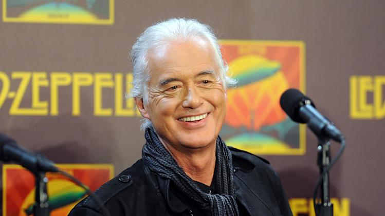 "Led Zeppelin Guitarist Jimmy Page participates in a press conference ahead of the worldwide theatrical release of ""Celebration Day"", a concert film of their 2007 London O2 arena reunion show, at the Museum of Modern Art on Tuesday, Oct. 9, 2012 in New York. (Photo by Evan Agostini/Invision/AP)"