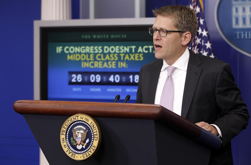 A middle class tax increase countdown clock is seen behind White House Press Secretary Jay Carney as he briefs reporters after President Barack Obama made a statement in the James Brady Press Briefing Room of the White House in Washington, Monday, Dec. 5, 2011. (AP Photo/Charles Dharapak)