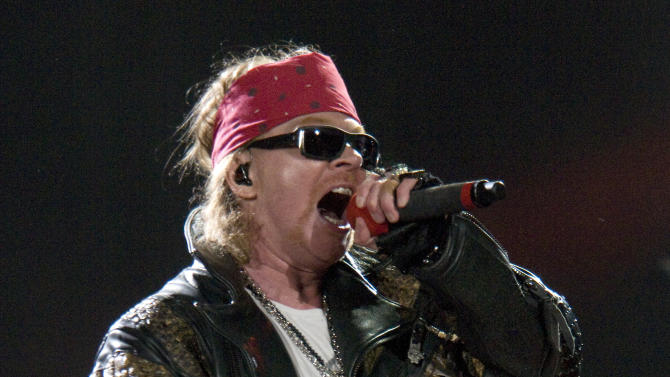 FILE - In an Aug. 14, 2010 file photo Guns N' Roses lead singer Axl Rose performs at the Rock and Rev Festival in Sturgis, S.D., during the 70th Annual Sturgis Motorcycle Rally.  Axl Rose announced Wednesday April 11, 2012 that he won't be showing up to see Guns N' Roses inducted into the Rock and Roll Hall of Fame and declined the honor for himself.   (AP Photo/Steve McEnroe/file)