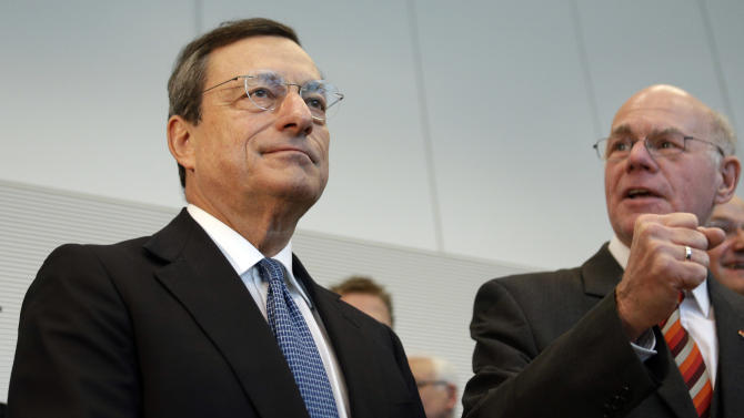The president of the European Central Bank, Mario Draghi, left, and the President of the German Federal Parliament, Bundestag, Norbert Lammert, right, arrive for a meeting with members of the parliament  in Berlin, Germany, Wednesday, Oct. 24, 2012. Draghi meets with German lawmakers to discuss his plans to buy bonds of ailing eurozone members. (AP Photo/Michael Sohn)