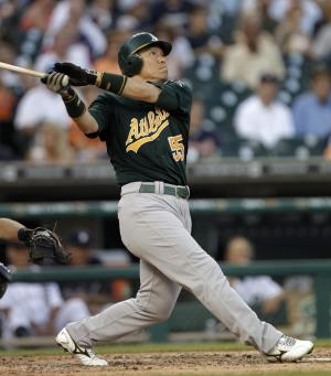 Oakland Athletics designated hitter Hideki Matsui, of Japan, hits a solo home run against the Detroit Tigers during the sixth inning of a baseball game, Wednesday, July 20, 2011, in Detroit.  (AP Photo/Paul Sancya)
