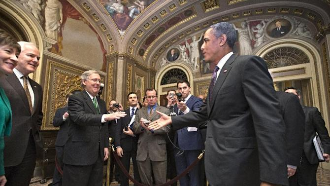 FILE – In this March 14, 2013, file photo President Barack Obama prepares to greet Senate Minority Leader, Republican Mitch McConnell, R–Ky., as he visits the U.S. Capitol to meet with the Senate Republican caucus in Washington. With each on the others' home turf, Republicans also dined at the White House, and talk, in public at least, focused on areas of possible collaboration. In reality however the past few weeks have simply shone the spotlight on the tension of this nation's say-one-thing-do-the-other politics. Others from left are Sen. Susan Collins, R-Maine, Minority Whip John Cornyn, R-Texas. (AP Photo/J. Scott Applewhite, File)