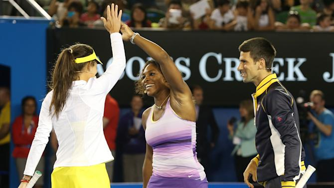 Serena Williams, centre, of the US celebrates with Serbia's Ana Ivanoic as Novak Djokovic looks on during an exhibition match on Rod Laver Arena during the Kids Tennis Day at Melbourne Park ahead of the Australian Open tennis championship in Melbourne, Australia, Saturday, Jan. 12, 2013. (AP Photo/Aaron Favila)