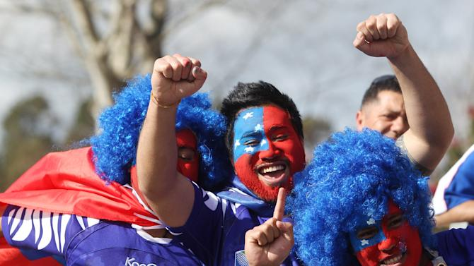 Samoan fans cheer their team on during their Rugby World Cup game against Namibia in Rotorua, New Zealand, Wednesday, Sept. 14, 2011.(AP Photo/Dita Alangkara)