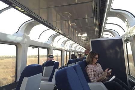 Passengers sit in the upper deck of a lounge car on Amtrak's Empire Builder as it travels between Minneapolis and Williston, North Dakota