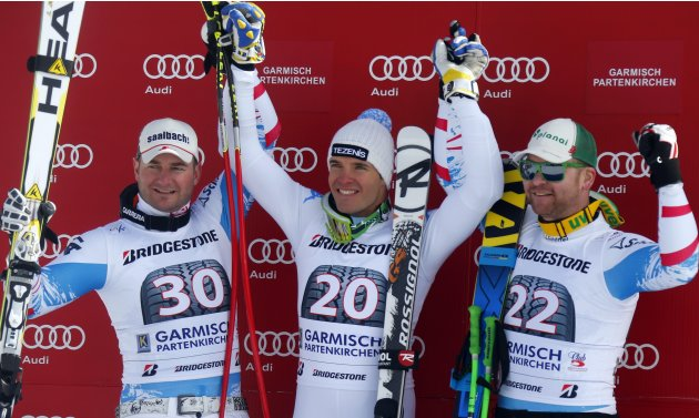 Winners podium after the men's Downhill ski race at the Alpine Skiing World Cup in Garmisch-Partenkirchen