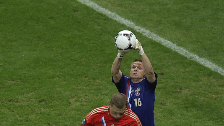 Russia goalkeeper Vyacheslav Malafeev deflects a ball the Euro 2012 soccer championship Group A  match between Greece and Russia in Warsaw, Poland, Saturday, June 16, 2012. (AP Photo/Gero Breloer)