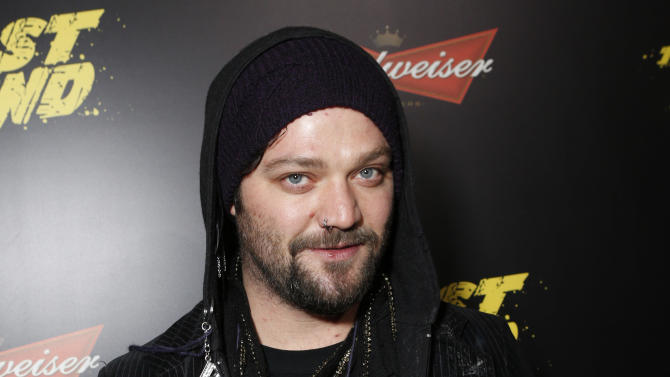 """FILE - This Jan. 14, 2013 file photo shows Bam Margera at the LA premiere of """"The Last Stand"""" at Grauman's Chinese Theatre in Los Angeles. Margera, star of """"Jackass,"""" put several dozen of his own paintings up for sale Tuesday at a barn on his property in West Chester, outside Philadelphia. The 33-year-old Margera let fans know about the art show in a tweet that day. (Photo by Todd Williamson/Invision/AP, file)"""