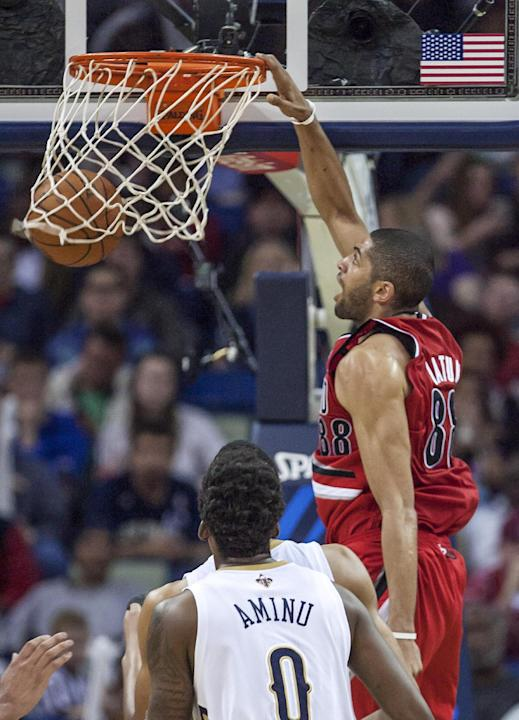 Portland Trail Blazers forward Nicolas Batum (88) dunks against against the New Orleans Pelicans in the second half of an NBA basketball game in New Orleans, Friday, March 14, 2014. The Trail Blazers