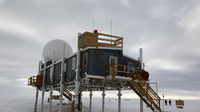 In this Friday, July 15, 2011 photo, scientists walk on the snow surrounding Summit Station, a small research facility situated 10,500 feet above sea level, on top of the Greenland ice sheet. Liz Morris, 64, of Cambridge University's Scott Polar Research Institute, left the station in July on a monthlong, 500-mile research trip on snowmobiles. Morris' research trip is funded by Britain's National Environmental Research Council and mounted with the U.S. National Science Foundation's cooperation. In 2003, Queen Elizabeth honored the intrepid Morris with a Polar Medal, given in recognition of distinguished service in Arctic and Antarctic exploration. Three years earlier the monarch inducted her into the Order of the British Empire. (AP Photo/Brennan Linsley)