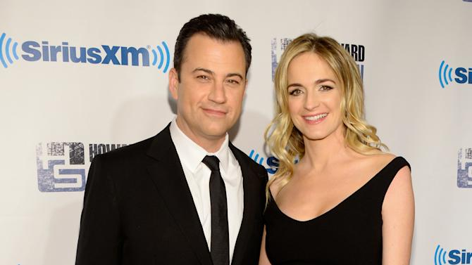 """FILE - In this Jan. 31, 2014 file photo, talk show host Jimmy Kimmel and wife Molly McNearney attend """"Howard Stern's Birthday Bash,"""" presented by SiriusXM, at the Hammerstein Ballroom in New York. Jimmy Fallon may be the late night host with a new show, but Kimmel has reason to celebrate too. Kimmel and McNearney are expecting their first child together, his rep Lewis Kay confirmed Monday, Feb. 24, 2014. (Photo by Evan Agostini/Invision/AP, file)"""