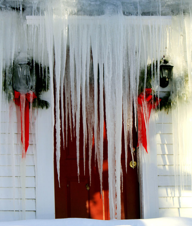 Icicles block the front door of a farm house, Monday, Jan. 24, 2011 in Canterbury, N.H.  as temperatures drop below zero overnight.  (AP Photo/Jim Cole)