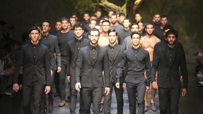 Models wear creations of the Dolce & Gabbana men's Spring-Summer 2014 collection, part of the Milan Fashion Week, unveiled in Milan, Italy, Saturday, June 22, 2013. (AP Photo/Luca Bruno)