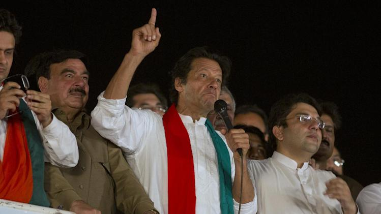 Pakistani cricket celebrity-turned-politician Imran Khan addresses his supporters during an anti-government sit-in protest in Islamabad, Pakistan, Friday, Aug. 29, 2014. Pakistan's prime minister on Friday denied asking the country's military chief to mediate with opposition leaders and protesters who have camped for two weeks outside parliament in the capital, Islamabad, demanding his resignation over alleged voting fraud. (AP Photo/B.K. Bangash)