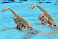 Russia's Natalia Ishchenko and Svetlana Romashina during their synchronised swimming duets final at the London Olympics on August 7. Russia can complete another sweep of the synchronised medals when the team event starts on Thursday
