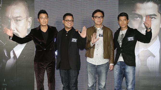"In this photo taken on Monday, Nov. 12, 2012, from left, Hong Kong actor Tony Leung Ka Fai,  directors Lok Man Leung, Sunny Luk, and actor Aaron Kwok pose for the media during a promotional event for their new film ""Cold War"" in Taipei, Taiwan. (AP Photo/Chiang Ying-ying)"