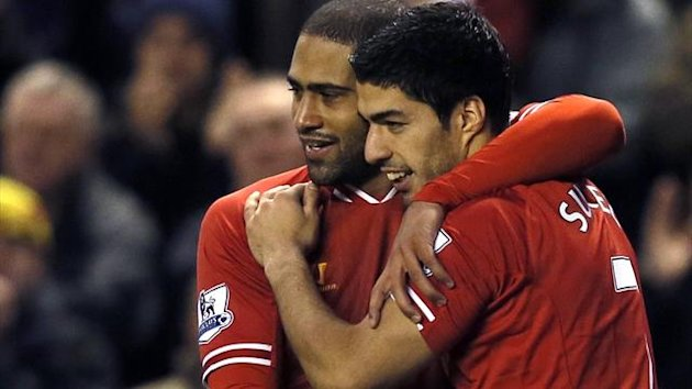Liverpool's Luis Suarez (R) celebrates with team-mate Glen Johnson (Reuters)