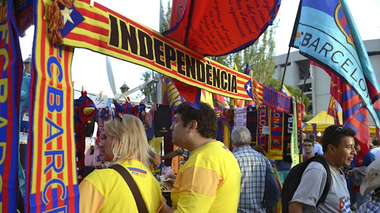 "FILE- In this Oct. 7, 2012, file photo, supporters of Barcelona before a Spanish La Liga soccer match against  Real Madrid at the Camp Nou Stadium, in Barcelona, Spain. More than ever, FC Barcelona, known affectionately as Barca, lived up to its motto of being ""more than a club"" for this wealthy northeastern region where Spain's economic crisis is fueling separatist sentiment. Barca has been seen as a bastion of Catalan identity dating back to the three decades of dictatorship when Catalans could not openly speak, teach or publish in their native Catalan language. Barcelona writer Manuel Vazquez Montalban famously called the football team ""Catalonia's unarmed symbolic army."" (AP Photo/Manu Fernandez, File)"