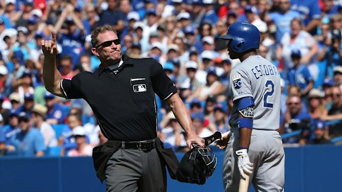 Home plate umpire Jim Wolf (L) ejects Aaron Sanchez of the Toronto Blue Jays after hitting Alcides Escobar of the Kansas City Royals in the eighth inning during MLB game action on August 2, 2015 at Rogers Centre in Toronto