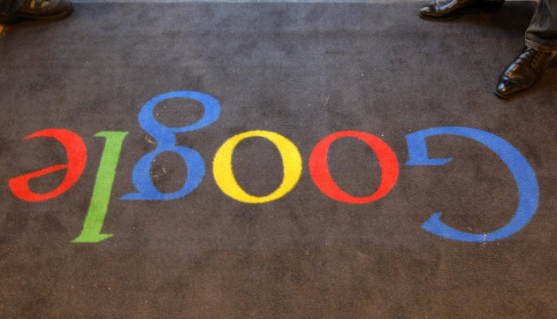 "FILE - In this Dec.6, 2011 file photo, the Google logo is seen on the carpet at Google France offices before its inauguration, in Paris. Publishers in France, Germany and Italy want their governments to impose a ""news tax"" on Google to save them from extinction, demanding a law that would charge the search engine small payments in exchange for links to stories. Google, in response, says it will cease to index the sites altogether, warning that the proposals do nothing to solve the industry's problems on the continent that invented the printing press. (AP Photo/Jacques Brinon, Pool, File)"