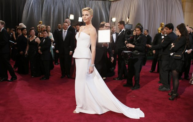 Actress Charlize Theron wearing white Dior Haute Couture column gown arrives at the 85th Academy Awards in Hollywood, California
