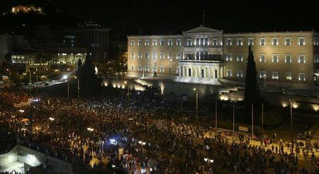A general view shows anti-austerity 'No' voters who gathered to celebrate in front of the Greek parliament in Syntagma Square in Athens