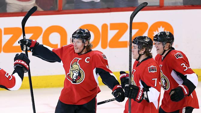 Ottawa Senators' Daniel Alfredsson celebrates his goal against the Montreal Canadiens with Kyle Turris (7) and Jakob Silfverberg (33) during the first period of Game 3 of their first-round NHL hockey Stanley Cup playoff series, Sunday, May 5, 2013, in Ottawa, Ontario. (AP Photo/The Canadian Press, Fred Chartrand)