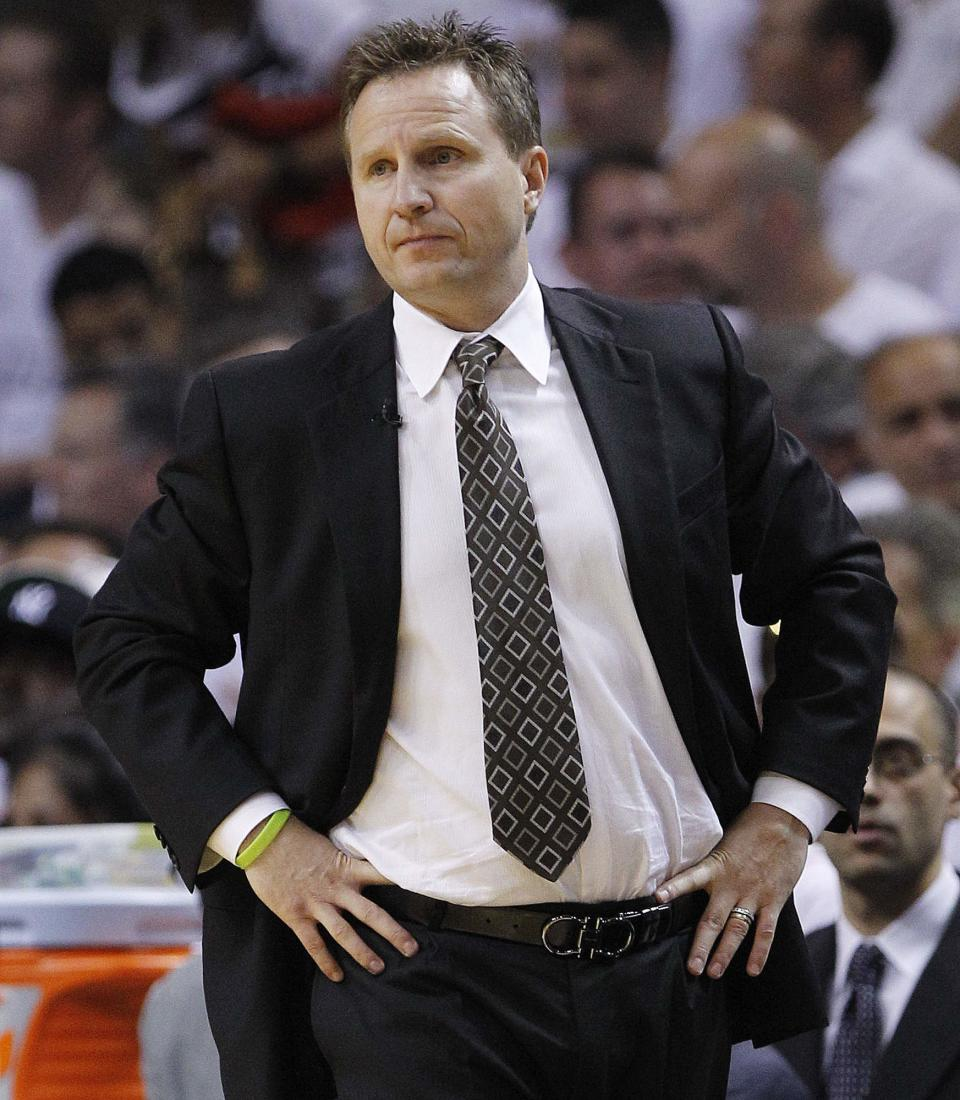 Oklahoma City Thunder head coach Scott Brooks watches action against the Miami Heat during the first half at Game 5 of the NBA finals basketball series, Thursday, June 21, 2012, in Miami. (AP Photo/Lynne Sladky)
