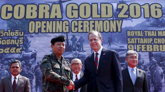 Royal Thai armed forces General Sommai Kaoteera and U.S. Ambassador to Thailand Glyn Davies shake hands during the opening ceremony for Cobra Gold military exercise in Chonburi
