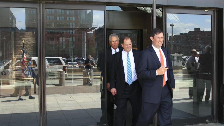Attorneys for British drugmaker GlaxoSmithKline leave U.S. District Court in Boston Thursday, July 5, 2012 after an agreement by the company to pay $3 billion for criminal and civil violations involving 10 drugs that are taken by millions of people was approved by a federal judge. It is the largest health care fraud settlement in U.S. history. (AP Photo/Elise Amendola)