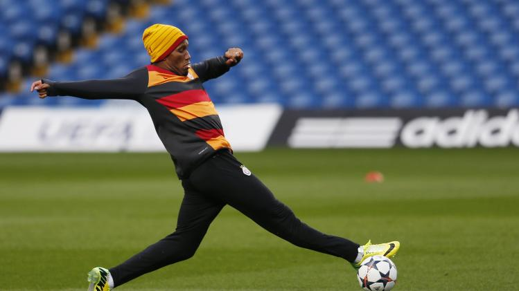 Galatasaray's Drogba kicks the ball during a training session at Stamford Bridge in London