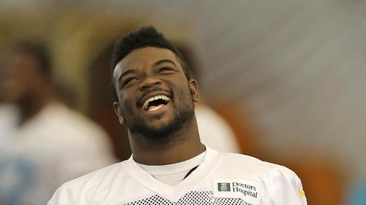 Miami Dolphins running back Damien Williams (5) laughs during NFL football training camp in Davie, Fla., Wednesday, July 30, 2014