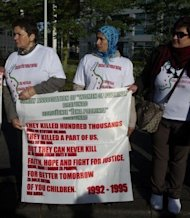 Bosnians demonstrate outside the International Criminal Tribunal for the former Yugoslavia (ICTY) in The Hague. The war crimes trial of former Bosnian Serb army chief Ratko Mladic has been abruptly halted, just a day after it opened, because of prosecution &quot;irregularities&quot; in the high-profile case