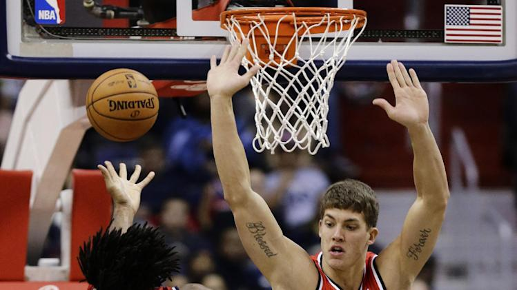 Portland Trail Blazers center Meyers Leonard goes up to block a shot by Washington Wizards center Nene in the first half of an NBA basketball game Wednesday, Nov. 28, 2012, in Washington. (AP Photo/Alex Brandon)