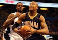 David West of the Indiana Pacers drives against Earl Clark of the Orlando Magic in game four of the Eastern Conference quarter-finals in the 2012 NBA Playoffs at Amway Center in Orlando, Florida. The Indiana Pacers squandered a big fourth-quarter lead but held on for a 101-99 over-time win over the Orlando Magic